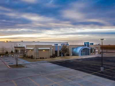 Exterior of Hillside Church at sunset, in Lubbock, Texas, with exterior commercial lighting.