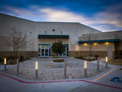 Exterior of Hillside Church alternate entrance at early evening, in Lubbock, Texas, with exterior commercial lighting.