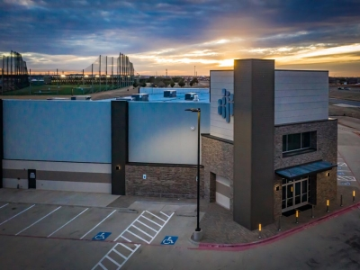 Alternate view of exterior of Hillside Church at sunset, in Lubbock, Texas, with exterior commercial lighting.