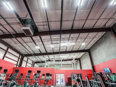 Interior of fitness club in lubbock, with commercial overhead electrical and lighting.