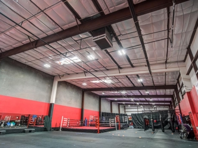 Interior of fitness club with boxing ring in Lubbock, with commercial overhead electrical and lighting.