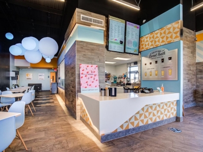 Interior of shaved ice cafe with commercial electrical work and overhead lighting.