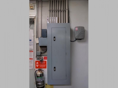 Commercial electrical panel and conduits in Lubbock beverage establishment.