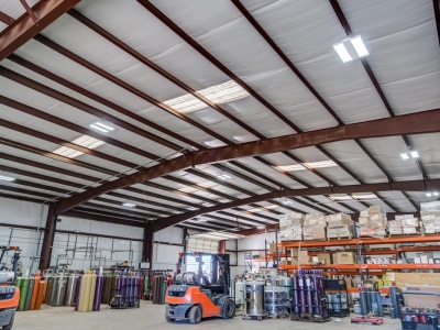 Interior storage warehouse at Lubbock industrial provider with specialty electrical work, control panels and conduits.