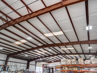 Interior storage warehouse at Lubbock industrial provider with specialty electrical work, control panels and conduits, including overhead LED lighting.