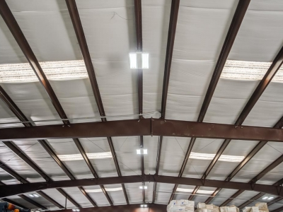 Overhead commercial electrical work and LED lighting in industrial workshop/warehouse.