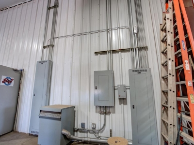 Interior warehouse at Lubbock industrial provider with specialty electrical work, control panels and conduits.