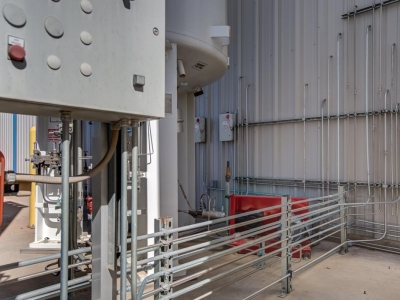 Exterior gas storage tanks at Lubbock industrial provider with specialty electrical work and conduits.