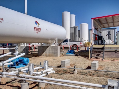 Exterior gas storage tanks at Lubbock industrial provider with specialty electrical work, control panels and conduits.